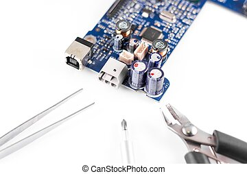 electronic circuit broken and repair tools, pliers, wire...