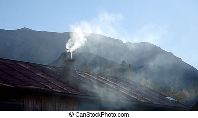 Smoke from the chimney in the autumn
