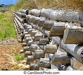 levee channel trunks wood and stone