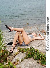 Bikini girl on the rocks.