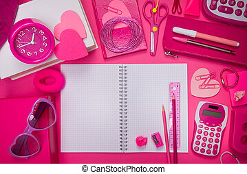 Girly pink desktop and stationery with blank notebook and...