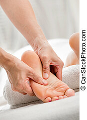 Foot Massage - A foot massage being carried out in a spa by...