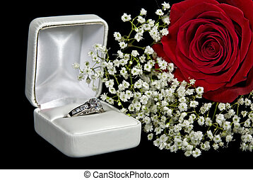The Ring Box - Diamond engagement ring in a box with rose.