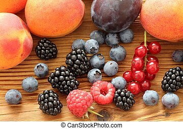 Fruits - Group of fresh fruits on wooden background