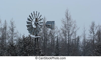 Winter windmill in rural Ontario. - Winter windmill used as...