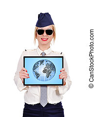 Flight attendant holding laptop with earth on screen