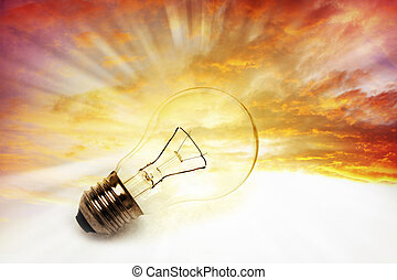 Light bulb on bright sky