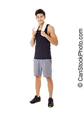 Full length  of smiling sportive young  man