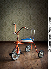 Vintage colorful tricycle - Vintage orange tricycle on...