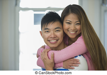 Happy Asian Couple together at home.