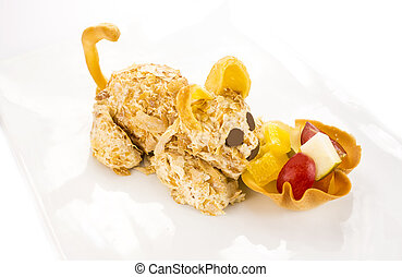 ice cream in the shape of a cat with fruit salad