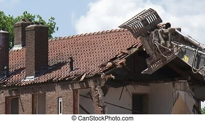 Urban renewal, demolish a tiled roof with shovel gripper -...