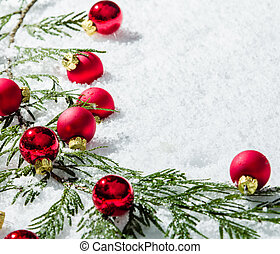 Border of evergreen bough with red balls - A border of green...