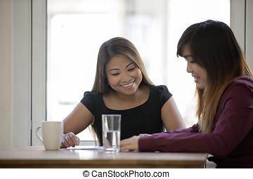 Happy Asian businesswomen in an office. - Two happy Asian...