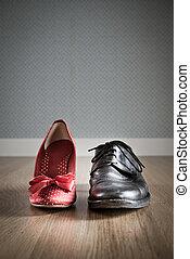 Love affinity - Male and female elegant shoes on hardwood...