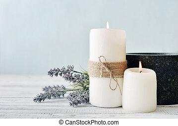Candles with lavender - Two candles with lavender flowers on...
