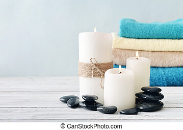 Candles with towels - Candles with bath towels on light blue...