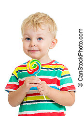 kid boy eating lollipop isolated on white