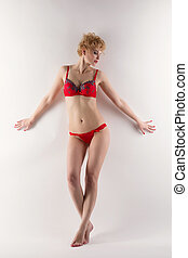 Image of blond woman posing in red underwear