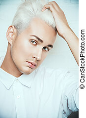 bleaching hair - Beautiful young man with sensual look...