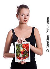 girl holding a tablet with photo of christmas presents