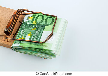 euro banknotes in mouse trap - many euro banknotes in a...