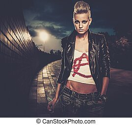 Punk girl with cigarette outdoors at night