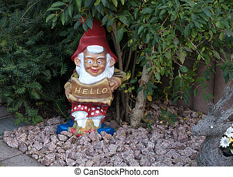Garden gnome mit HELLO shield - A garden gnome with red...