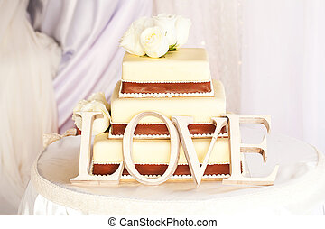 Wedding cake and love - White wedding cake and letters love