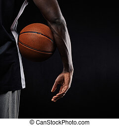 Basketball in hand of a young player