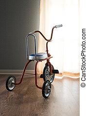 Vintage orange tricycle