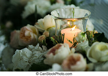 Candle around the flowers - Candle in the glass around the...