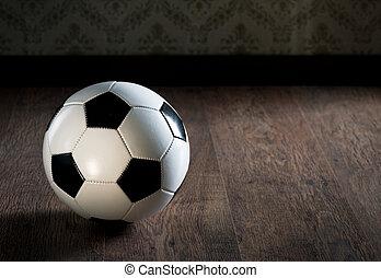 Soccer ball on hardwood floor