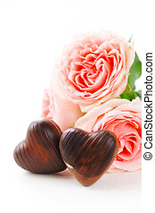 chocolate candy hearts and pink roses for Valentines day...