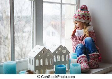 Smile funny little girl - Little girl sitting on a window...
