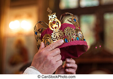 Moment of coronation - Crown in the hands of the pastor at...