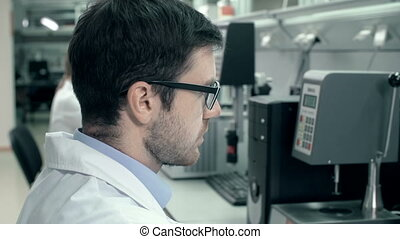 Scientific Work - Close up of lab assistant in uniform...