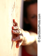 Woman hand on the wall