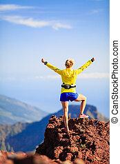 Climbing success, woman cross country runner