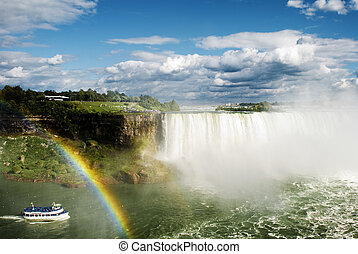 Niagara Falls - Boat passing next to rainbow in Niagara...