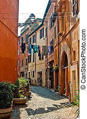 Narrow old street in the city of Rome at daytime