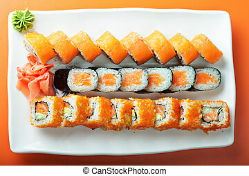 Salmon rolls above view - Salmon rolls over the orange table...