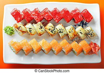 Different sushi rolls above view photo