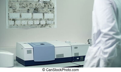Infrared Spectrometer - Panoramic shot of laboratory...