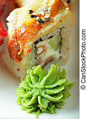 Wasabi with piece of sushi closeup photo