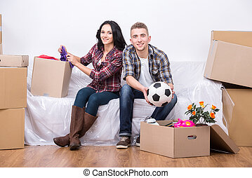 Moving home - Couple are moving into a new home and...
