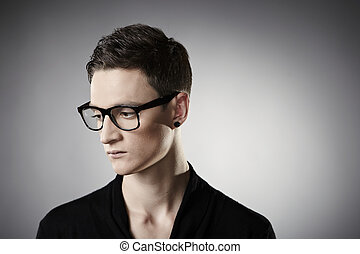 Bad mood - Young man posing in studio for personal and...