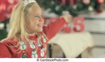 Little girl with long blond hair and blue eyes rejoices, having fun and laughing with her mother