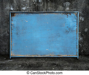 old blue blank weathered wooden board on dark mottled background