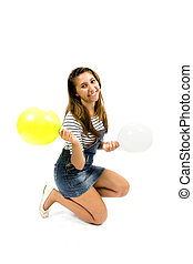 Smiling girl with sportswear and colorful balloons